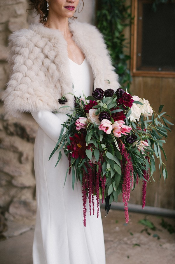 Bride holding winter wedding bouquet