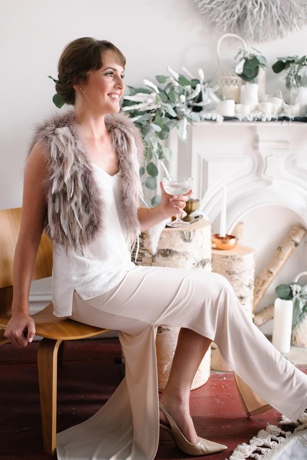 Bride sitting holding drink