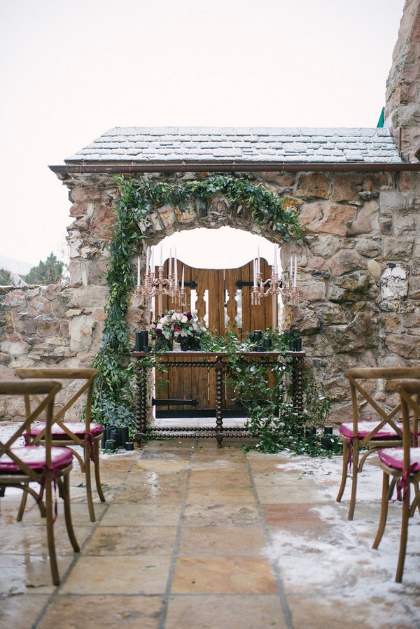 Winter wedding ceremony table in courtyard of Cherokee Castle