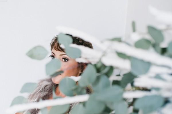 Bride behind foliage