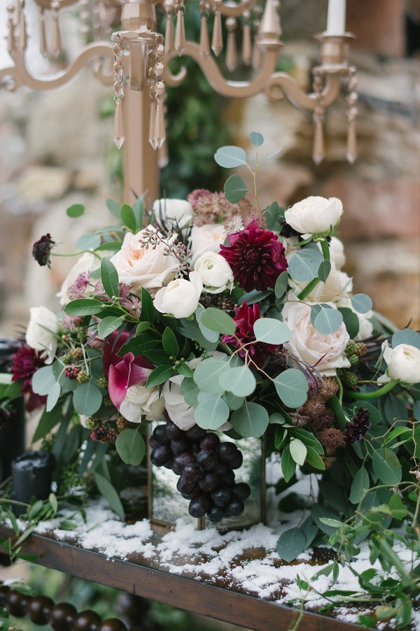 Winter wedding ceremony table flowers