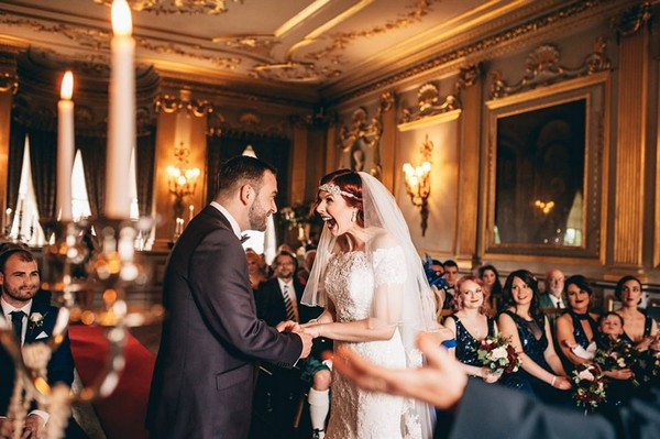 Bride with mouth open wide in excitement at having just got married - Picture by Andrea Ellison Photography