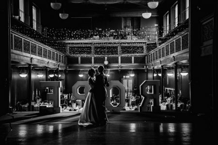 Bride and groom dancing on stage at wedding venue - Picture by Penny Young Photography