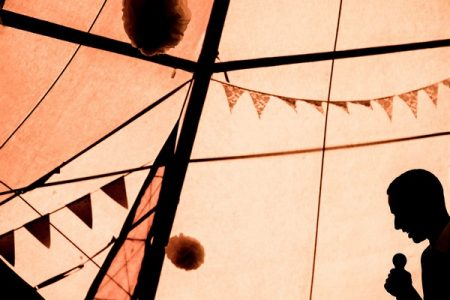 Silhouette of man giving wedding speech in tipi - Picture by Andrew Billington Photography