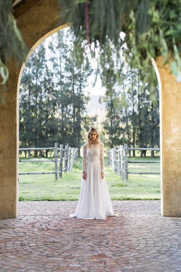 Bride standing under arch