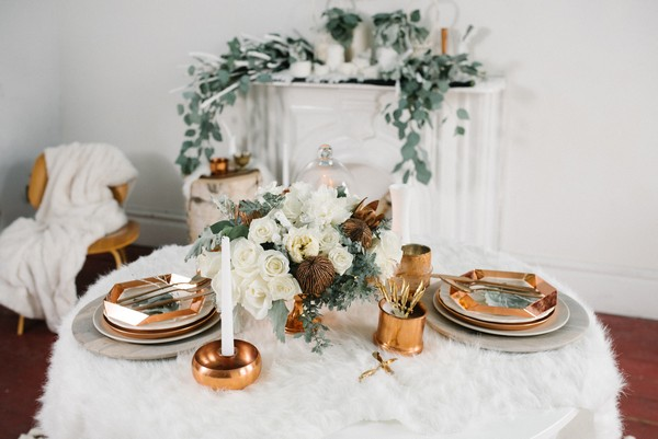White and copper wedding table styling