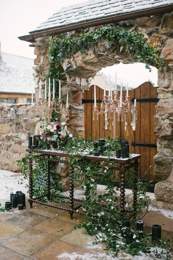 Wedding ceremony table with foliage and candelabra