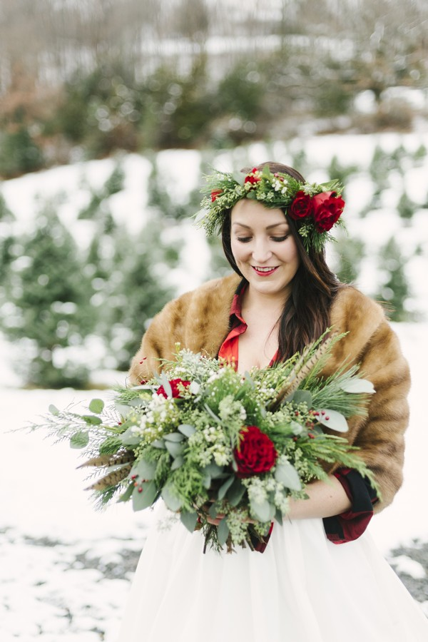 Bride with rose and foliage crown holding winter wedding bouquet