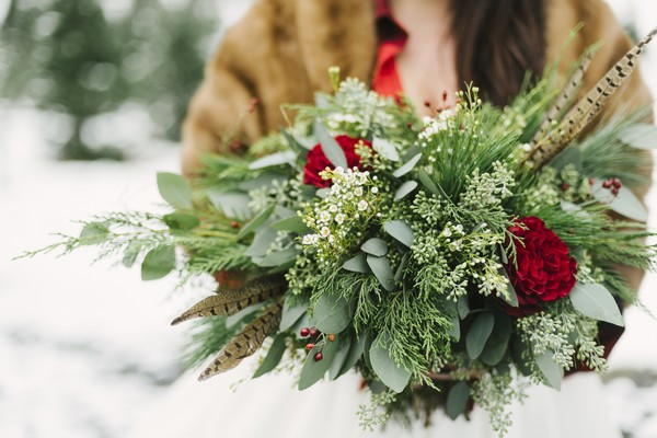 Brides winter wedding bouquet with foliage and roses