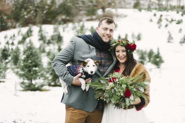 Bride with groom holding a dog