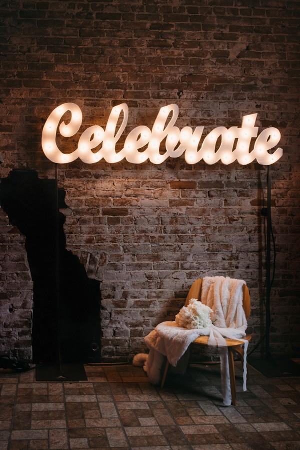 Fur on chair below celebrate sign