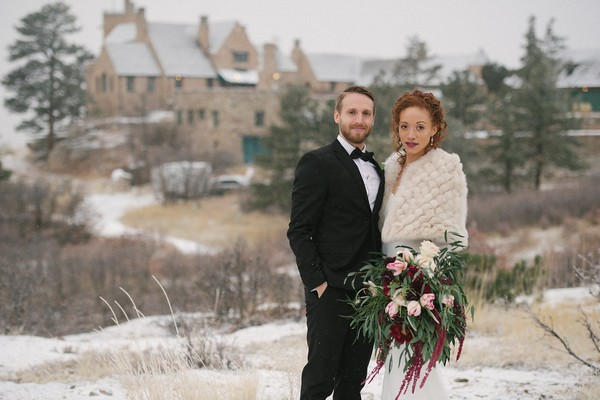 Bride and groom in snow at Cherokee Castle