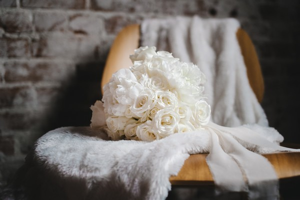 White bouquet on fur on chair