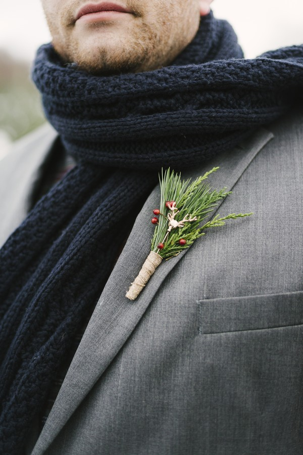 Deer pin in groom's winter buttonhole