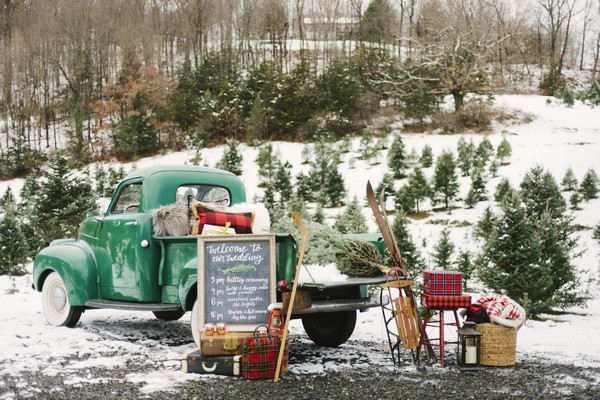 Back of truck full of vintage winter wedding decor