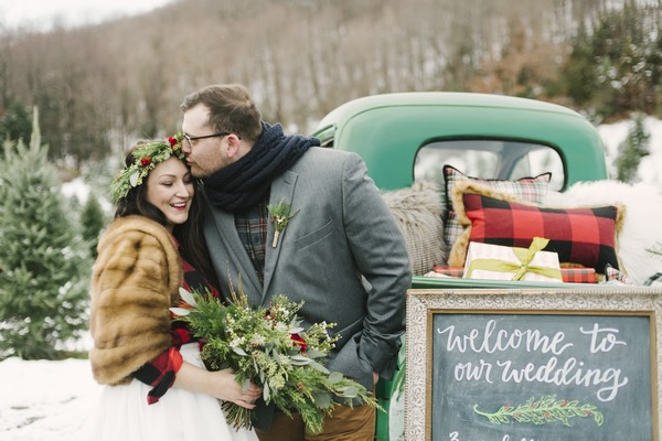 Groom kissing bride on the head