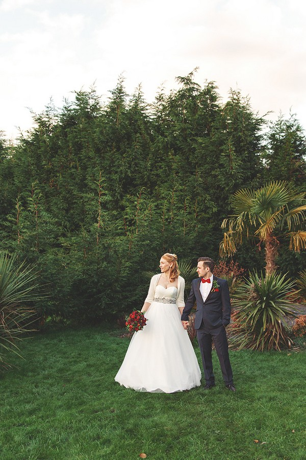 Bride and groom in grounds of The Watermill Hotel