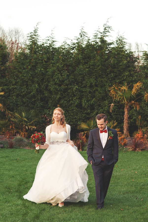 Bride and groom walking in grounds of The Watermill Hotel