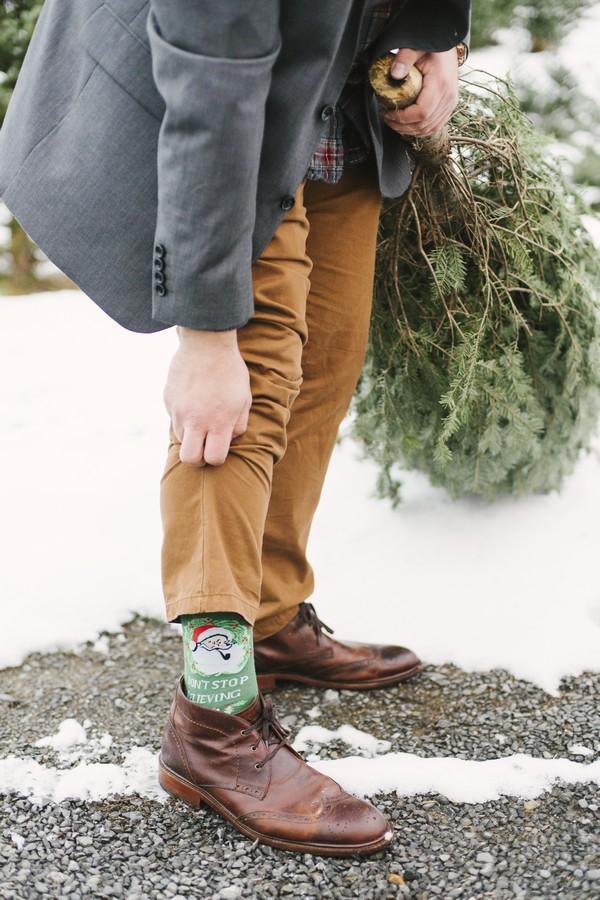 Groom wearing Christmas socks