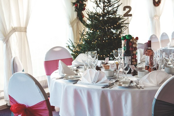 Christmas tree behind wedding top table