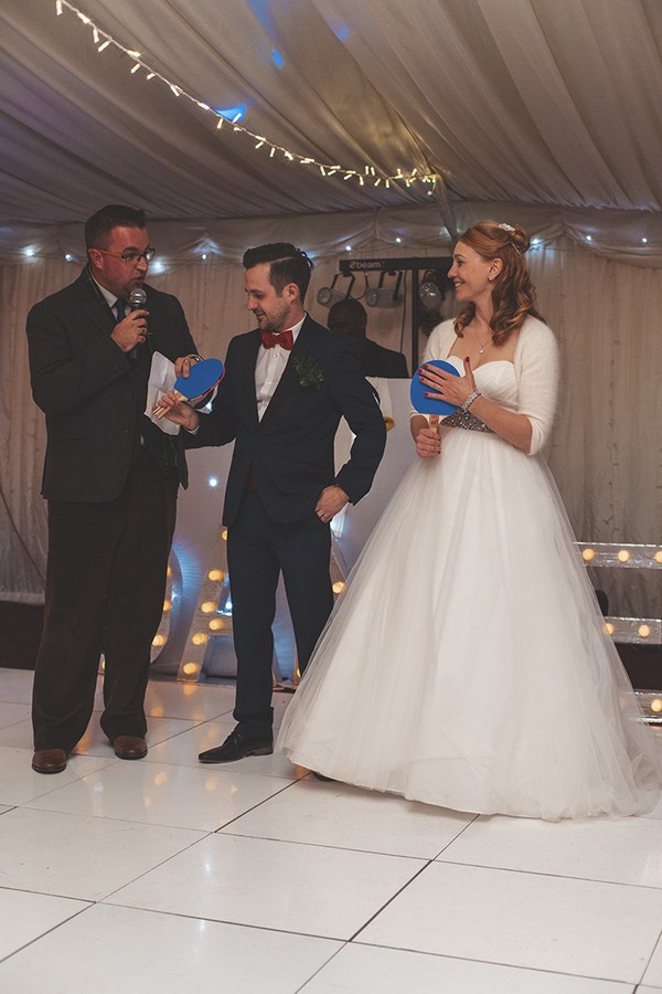 Bride and groom playing Mr and Mrs game