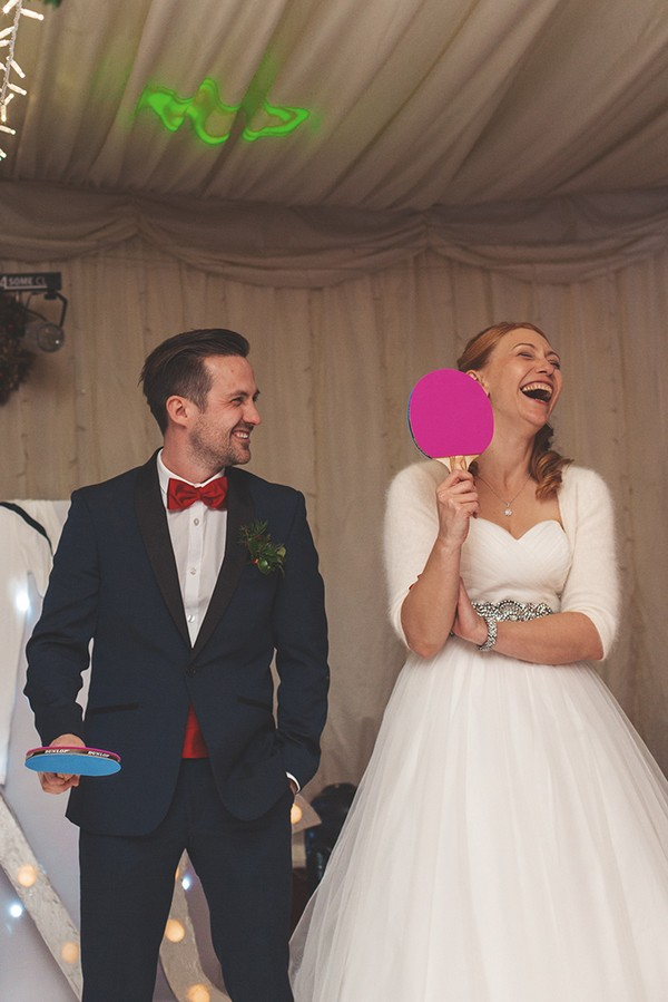 Bride laughing as she plays Mr and Mrs game