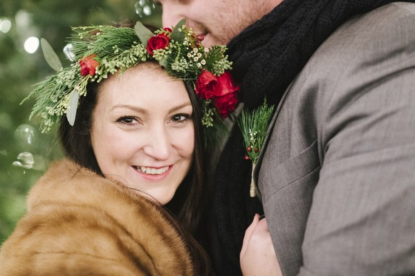 Bride with rose and foliage crown smiling