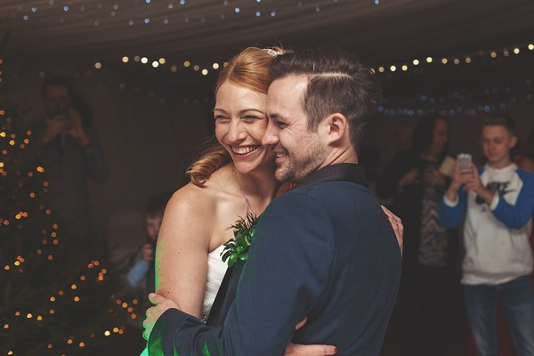 Bride and groom smiling on dance floor