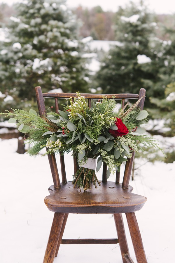 Winter bridal bouquet on chair
