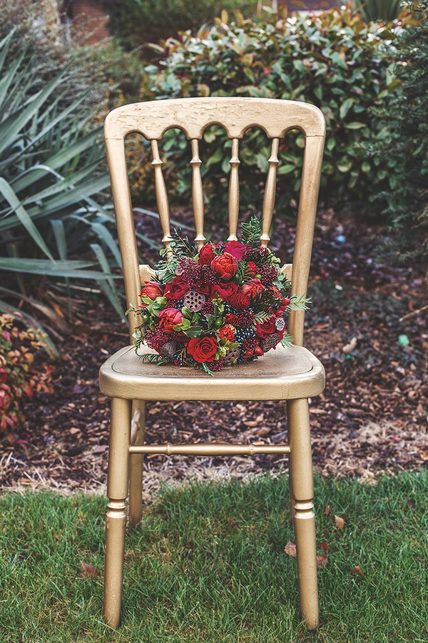 Red wedding bouquet on chair