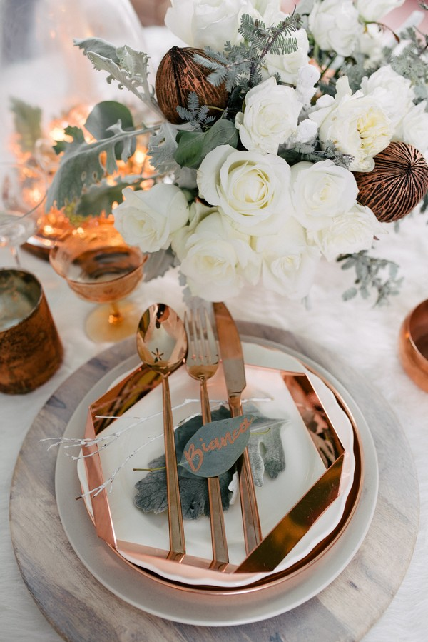 Wedding place setting with white and copper styling