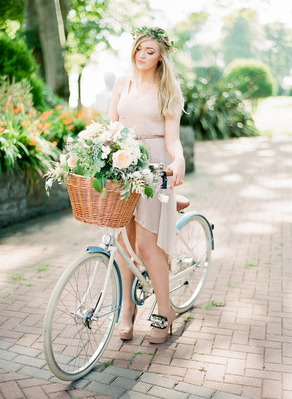 Bride on Bicycle with Basket of Summer Flowers and Foliage