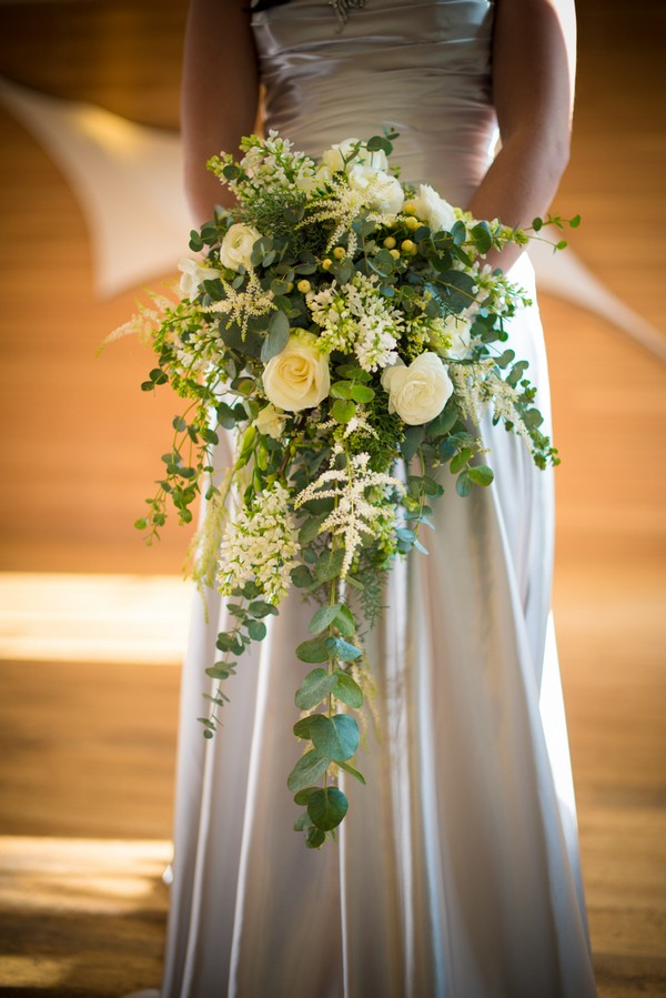 Bride Holding Cascading Bouquet with Roses and Foliage
