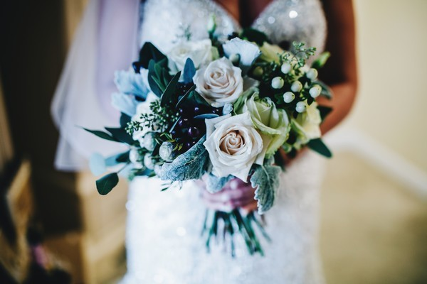 Winter Wedding Bouquet with Roses and Dark Green Leaves