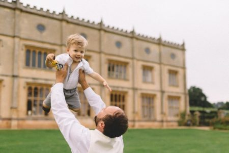 Man lifting boy up in the air