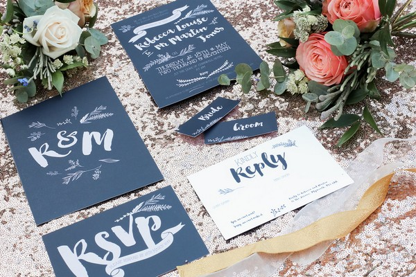 Dark blue wedding stationery with white lettering