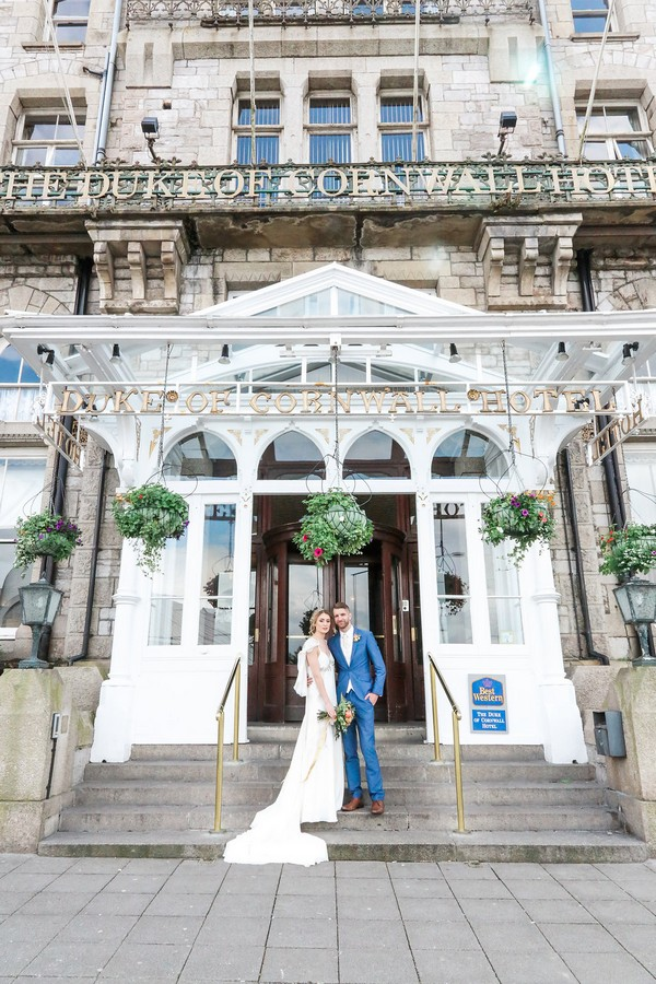 Bride and groom outside The Duke of Cornwall Hotel