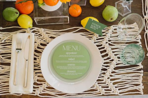 Round green wedding menu on plate
