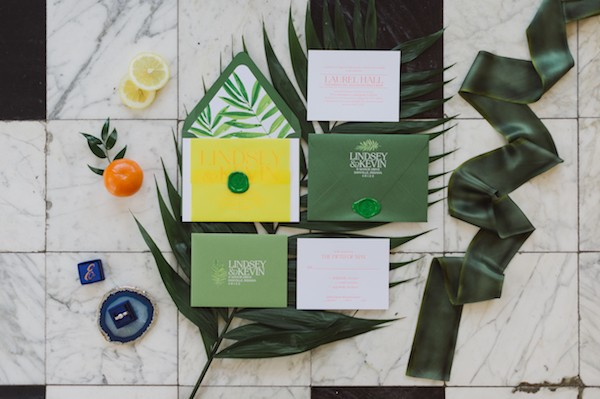 Green tropical themed wedding stationery