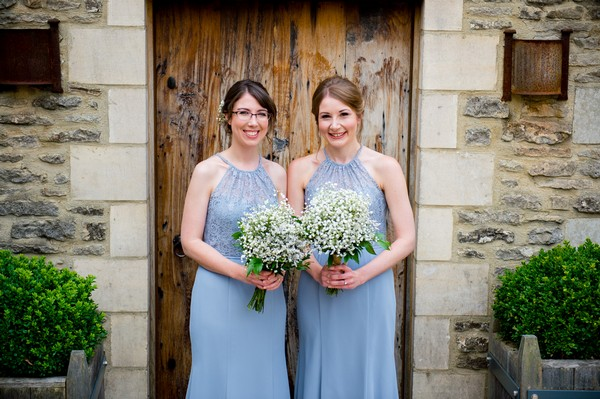 Bridesmaids in blue Dessy dresses