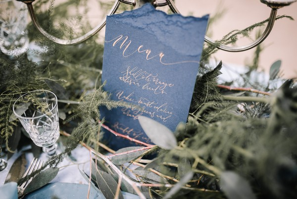 Blue wedding menu with gold calligraphy