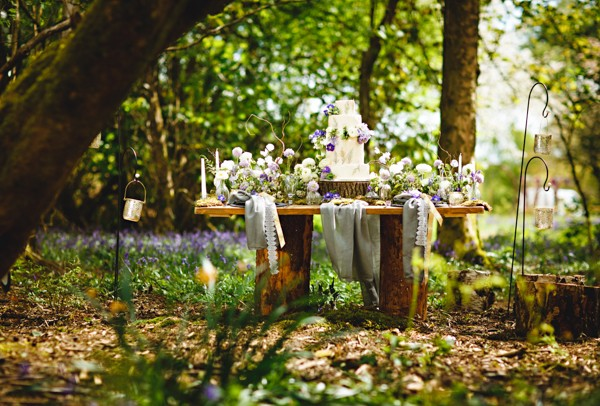 Table in woods with woodland wedding styling