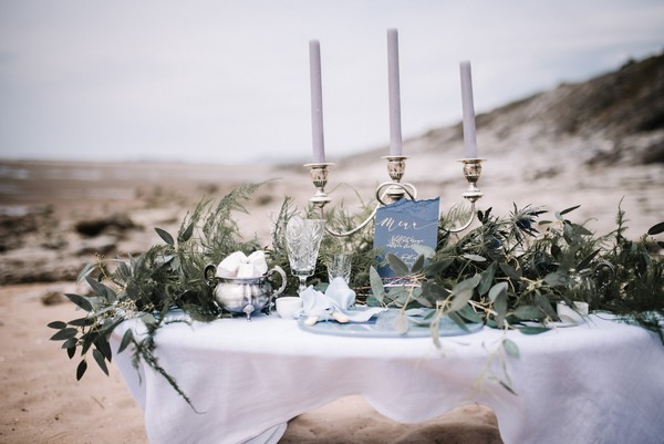 Naturally styled wedding table on beach