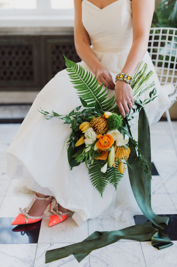 Bridal bouquet of bright flowers and foliage