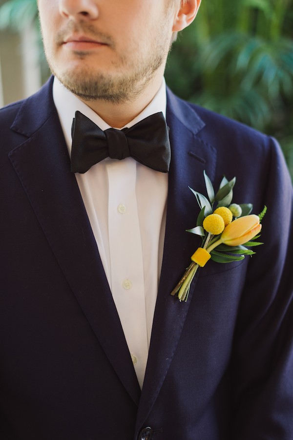Groom's yellow tied style buttonhole