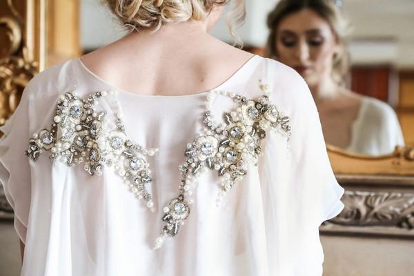 Crystal detail on back of bride's wedding dress