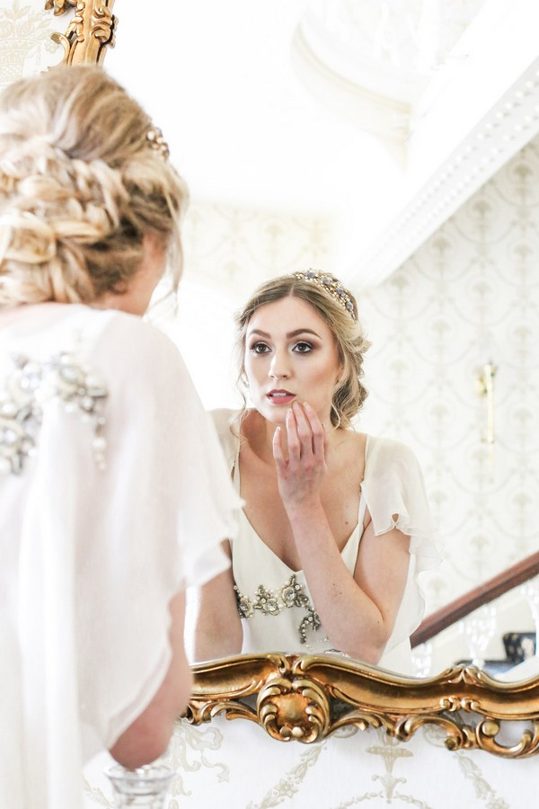 Bride checking make-up in mirror