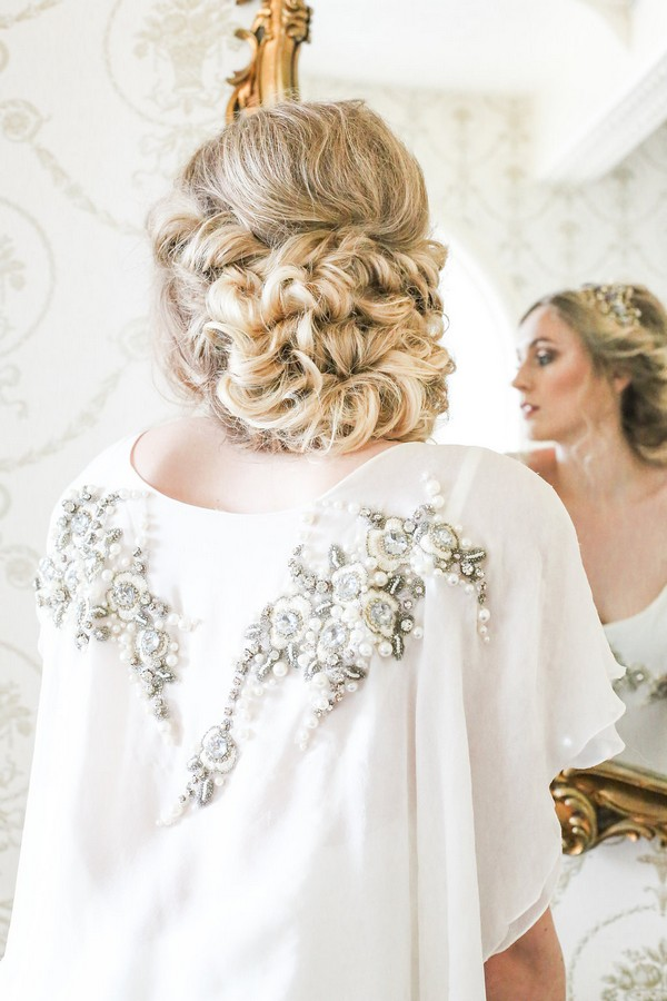 Back of bride's curled updo hairstyle