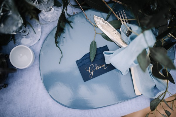 Blue styled groom wedding place setting