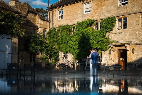 Bride and groom in courtyard of wedding venue - Picture by Nick Church Photography